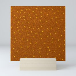 small yellow squares superimposed on a brown pattern Mini Art Print