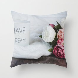 white-and-pink-flowers-beside-a-canister Throw Pillow