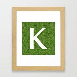 K initial letter alphabet on the grass Framed Art Print
