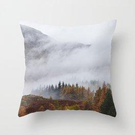 Rain clouds sweeping through the mountains near Blea Tarn. Cumbria, UK. Throw Pillow