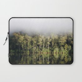 A tree lined lake on a foggy winter's Day Laptop Sleeve