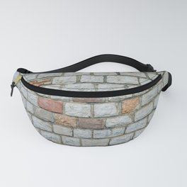 Wall of white bricks and other colors Fanny Pack