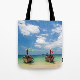 Long tail boats on the beach in Thailand Tote Bag