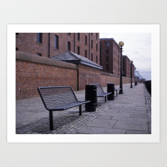 a row of benches Art Print