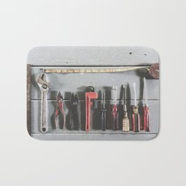 tools on the wood table with wrench tool, screwdriver, ruler and pliers Bath Mat