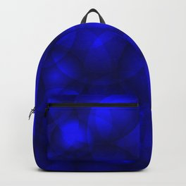 Glowing blue soap circles and volume sea bubbles of air and water. Backpack
