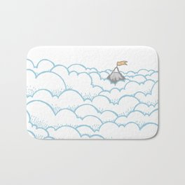 Peak above the clouds Bath Mat