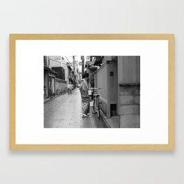 Woman with bicycle Framed Art Print