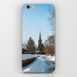 Heavy snow on a street in a traditional Romanian village iPhone Skin