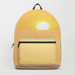 Peachy sunrise seascape Backpack
