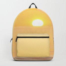 Peachy sunrise seascape Backpack