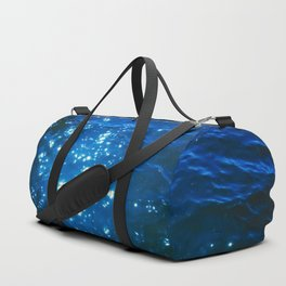 light of the star on the blue water Duffle Bag