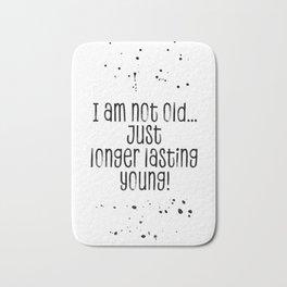 TEXT ART I am not old, just longer lasting young Bath Mat