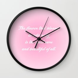The Flower That Blooms Wall Clock