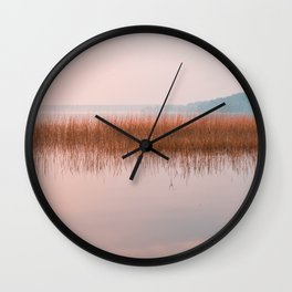 Sunset lake landscape, pink lake view on bullrushes with reflection Wall Clock