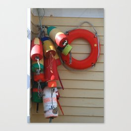 Fishnet Wooden and Styrofoam Floats hang to dry Canvas Print
