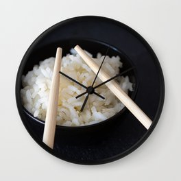 Rice bowl with Chinese chopsticks on dark background Wall Clock