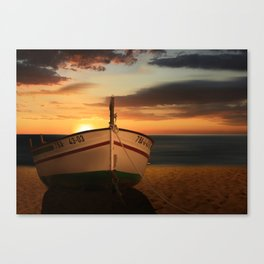 The boat in the sunset Canvas Print