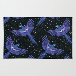 Hyacinth blue macaw parrots on the starry night sky Rug