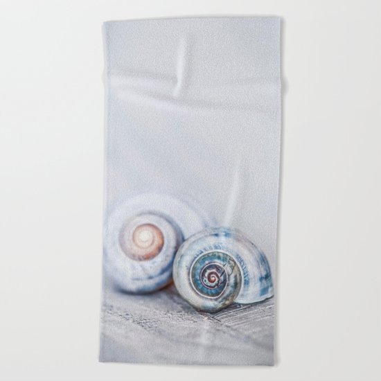 Blue Shells on white washed wood in soft pastel blues Beach Towel