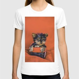 Tiny Yorkie Puppy Sitting in a Red & Black Basket surrounded with Christmas Red Fabric T-shirt