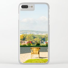 A couple of chairs on the top of a lookout watching the landscape I Clear iPhone Case