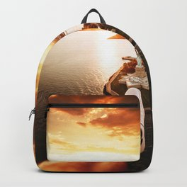 flying over the statue of liberty Backpack