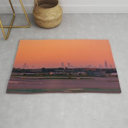 Empty Airport Runways with Chicago Skyline Silhouette and Orange Sunrise Rug