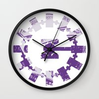 interstellar Wall Clocks featuring interstellar  by Osman SARGIN