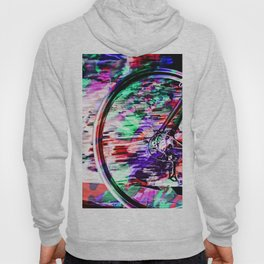 bicycle wheel with colorful abstract background in green red and purple Hoody
