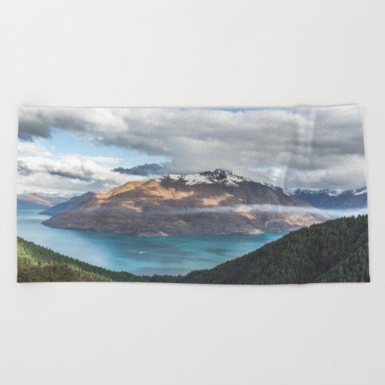 Island clouds Beach Towel