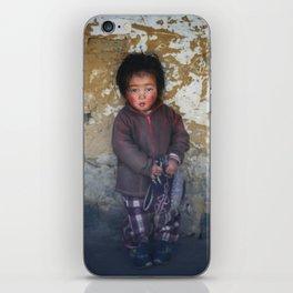 Portrait of serious young Nepali boy  in Lukla, Nepal  iPhone Skin