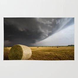 Spinning Gold - Storm Over Hay Bales in Kansas Field Rug