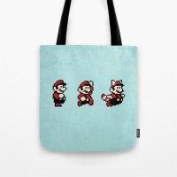 mario bros Tote Bags featuring Super Mario Bros 3 by Brandon Riesgo