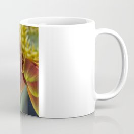 Macro photograph of a water drop on a yellow & orange Gerbera Daisy  petal with added lens flare. Coffee Mug