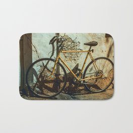 Old Bike Against And Old Wall Bath Mat