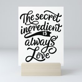 The secret ingredient is alway love - Funny hand drawn quotes illustration. Funny humor. Life sayings. Sarcastic funny quotes. Mini Art Print