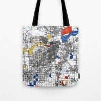 kansas city Tote Bags featuring Kansas city mondrian map by Mondrian Maps