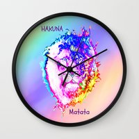 hakuna Wall Clocks featuring Hakuna Matata by Laura Santeler