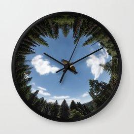 Bird flying over trees Wall Clock