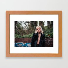 Girl by wall Framed Art Print