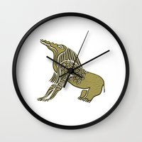 soul eater Wall Clocks featuring Egyptian demon - Bone Eater by siloto