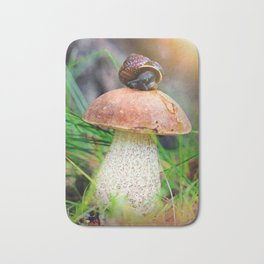 Leccinum on grass with snail Bath Mat