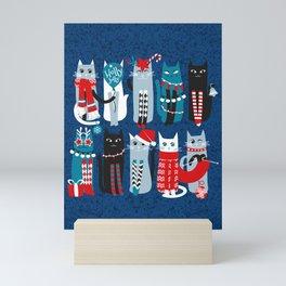 Feline Christmas vibes // blue background blue white and black kittens Mini Art Print