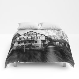 Old timbered house Comforters