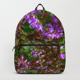Heather flowers in green leaves Backpack
