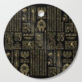 Egyptian hieroglyphs and deities gold on black Cutting Board