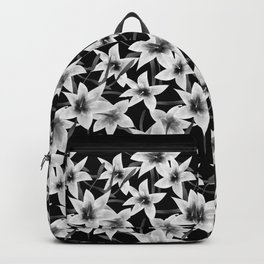White lilies on a black background . Backpack