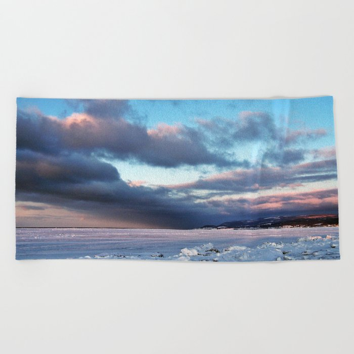 Storm Cloud Across Frozen Bay Beach Towel