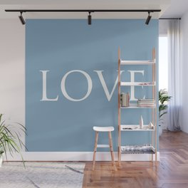 Love word on placid blue background Wall Mural